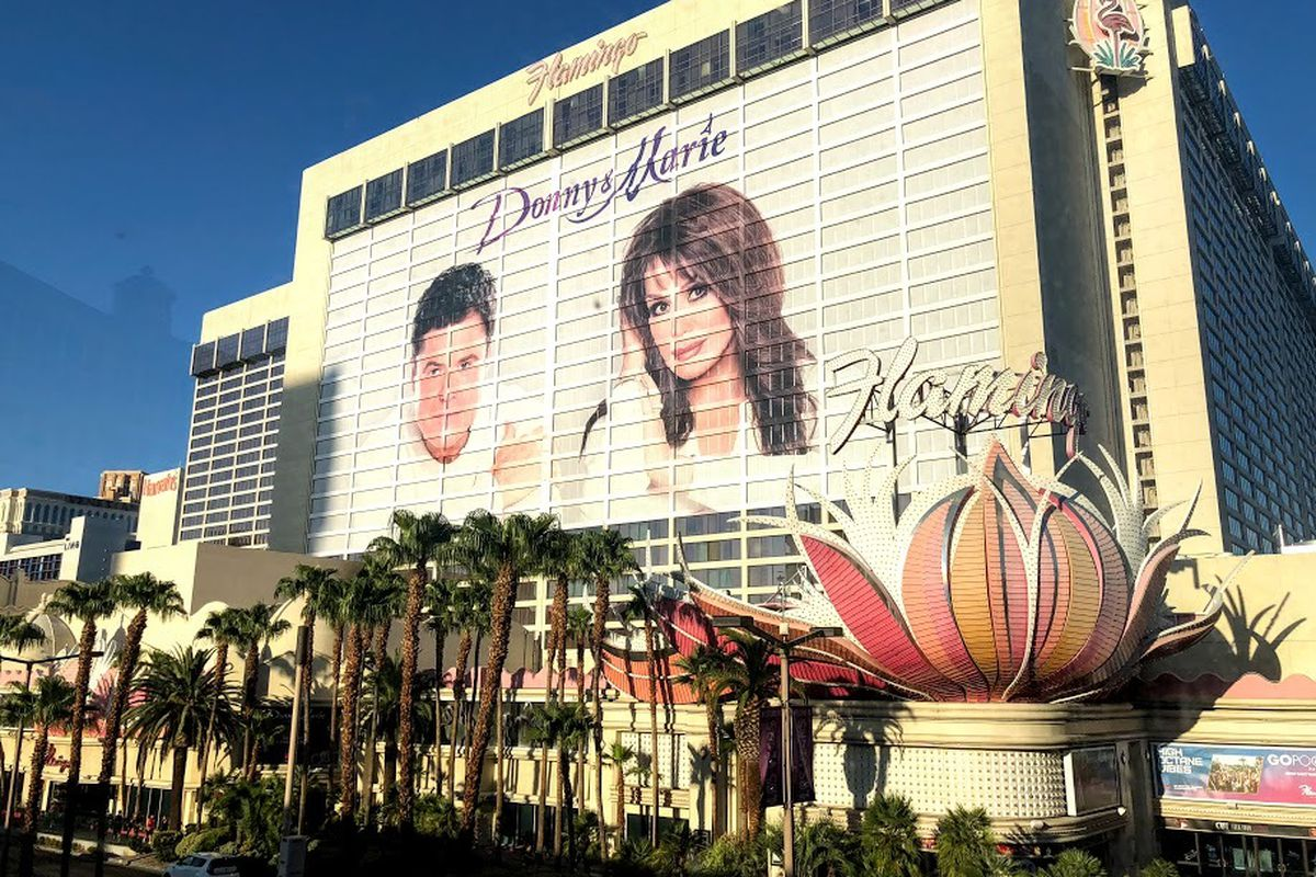 The faces of Donny and Marie Osmond adorn the side of the Flamingo Hotel in Las Vegas, site of their long-running show.