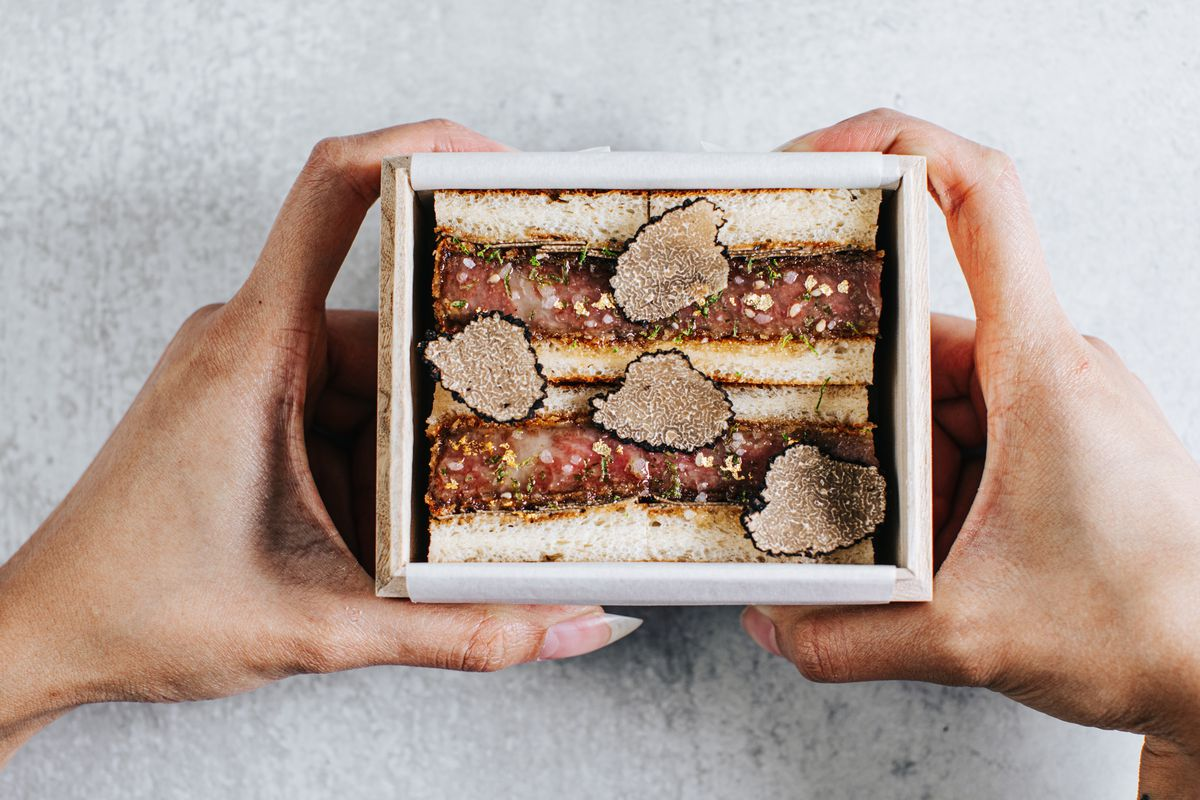 a milk bread sando topped with truffled and gold flake