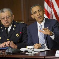 President Barack Obama, right, seated with Charles Ramsey, left, Commissioner Philadelphia Police Dept., speaks during his meeting with elected officials, law enforcement officials and community and faith leaders in the Old Executive Office Building on the White House Complex in Washington, Monday, Dec. 1, 2014. Obama said that in the wake of the shooting of an unarmed 18-year-old man in Ferguson, Missouri, he wants to make sure to build better trust between police and the communities they serve.