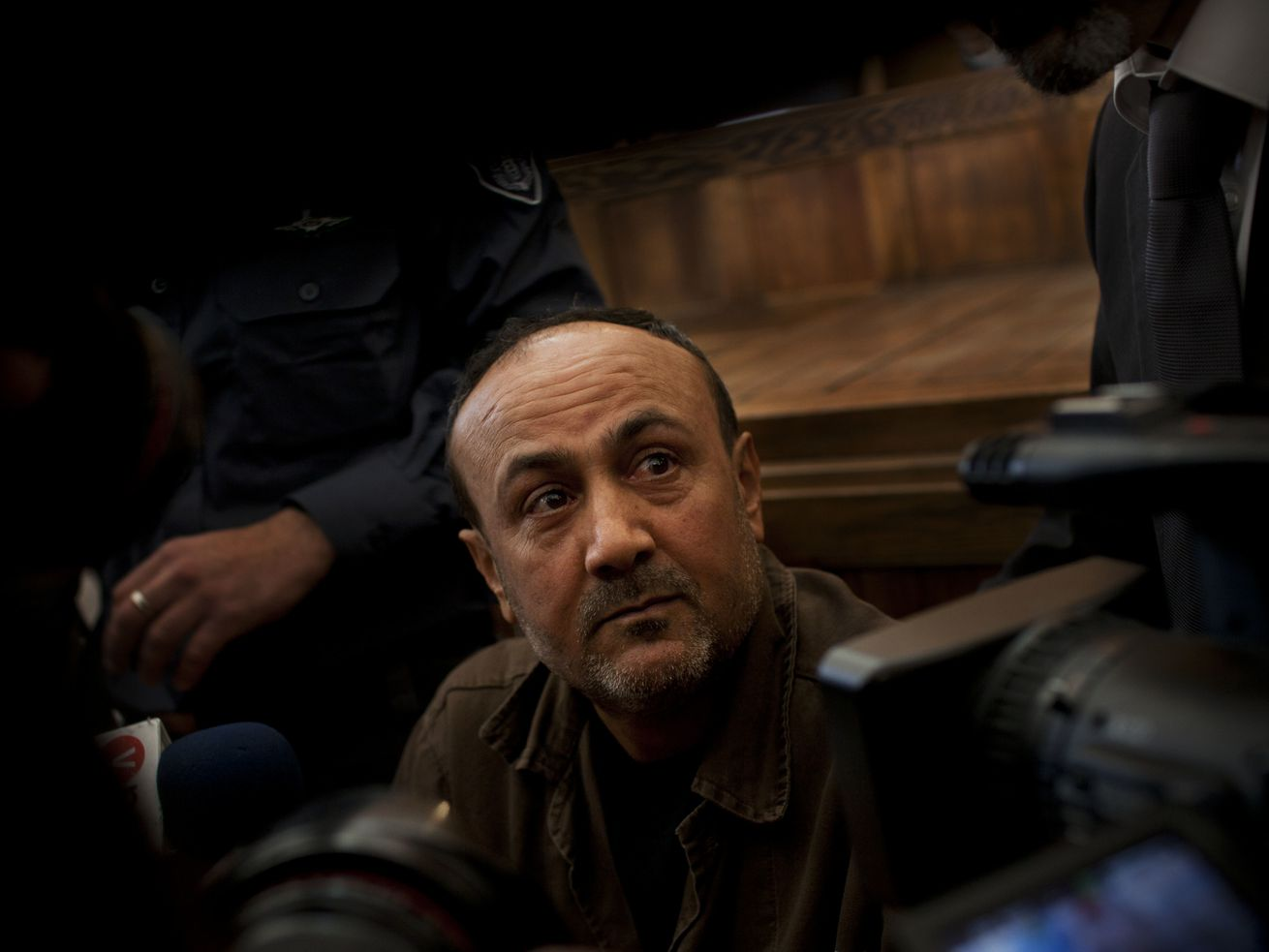 In this file photo taken Jan. 25, 2012, senior Fatah leader Marwan Barghouti appears at Jerusalem's court. Supporters of the popular Palestinian leader jailed by Israel say he will back his own parliamentary list in May elections.