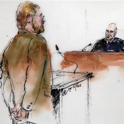 This courtroom sketch shows Daniel King, the defense attorney for suspected theater shooter James Holmes, talking to District Judge William B. Sylvester  during a motions hearing in district court in Centennial, Colo., on Thursday, Sept. 20, 2012. Holmes has been charged in the shooting at the Aurora theater on July 20 that killed twelve people and injured more than 50.