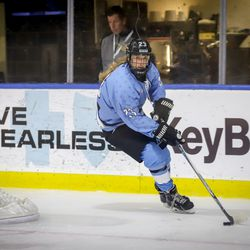 Buffalo Beauts forward Corinne Buie looks up ice as she moves the puck during a NWHL preseason game versus Team China at HarborCenter in Buffalo, NY on Oct. 9th, 2017.