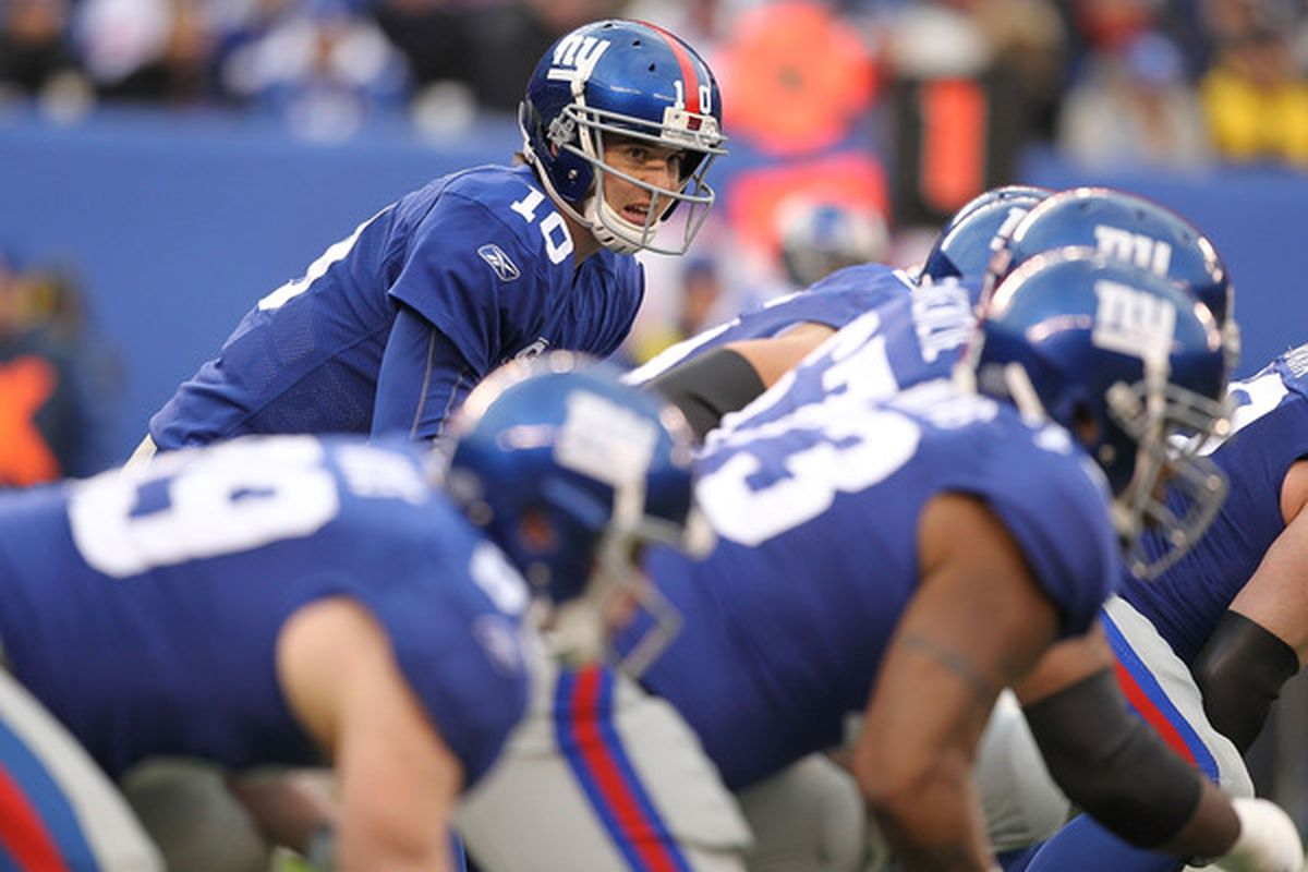 Eli Manning (10) of the New York Giants gets ready for the snap during a game against  the Philadelphia Eagles on December 19 2010 at The New Meadowlands Stadium in East Rutherford New Jersey.  (Photo by Al Bello/Getty Images)