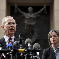 FILE - In this Jan. 26, 2012, file photo Dana Boente, First Assistant U.S. Attorney for the Eastern District of Virginia, left, with Jacqueline Maguire, Supervisory Special Agent, FBI Washington Field Office, speaks outside federal court in Alexandria, Va., after former Marine Yonathan Melaku pleaded guilty to charges that he fired shots at the Pentagon, the Marine Corps museum and other military-related targets. The FBI's big break came in June 2011, when Melaku was caught trespassing after dark in Arlington National Cemetery. This is one of several investigations into terrorism or hate crimes that are being honored Monday night, Sept. 24, 2012, at the annual Shield Award ceremony for the Anti-Defamation League.