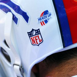 Aug 16, 2013; Orchard Park, NY, USA;  A view of the Heads Up Football logo on a Buffalo Bills players helmet before a game against the Minnesota Vikings at Ralph Wilson Stadium.