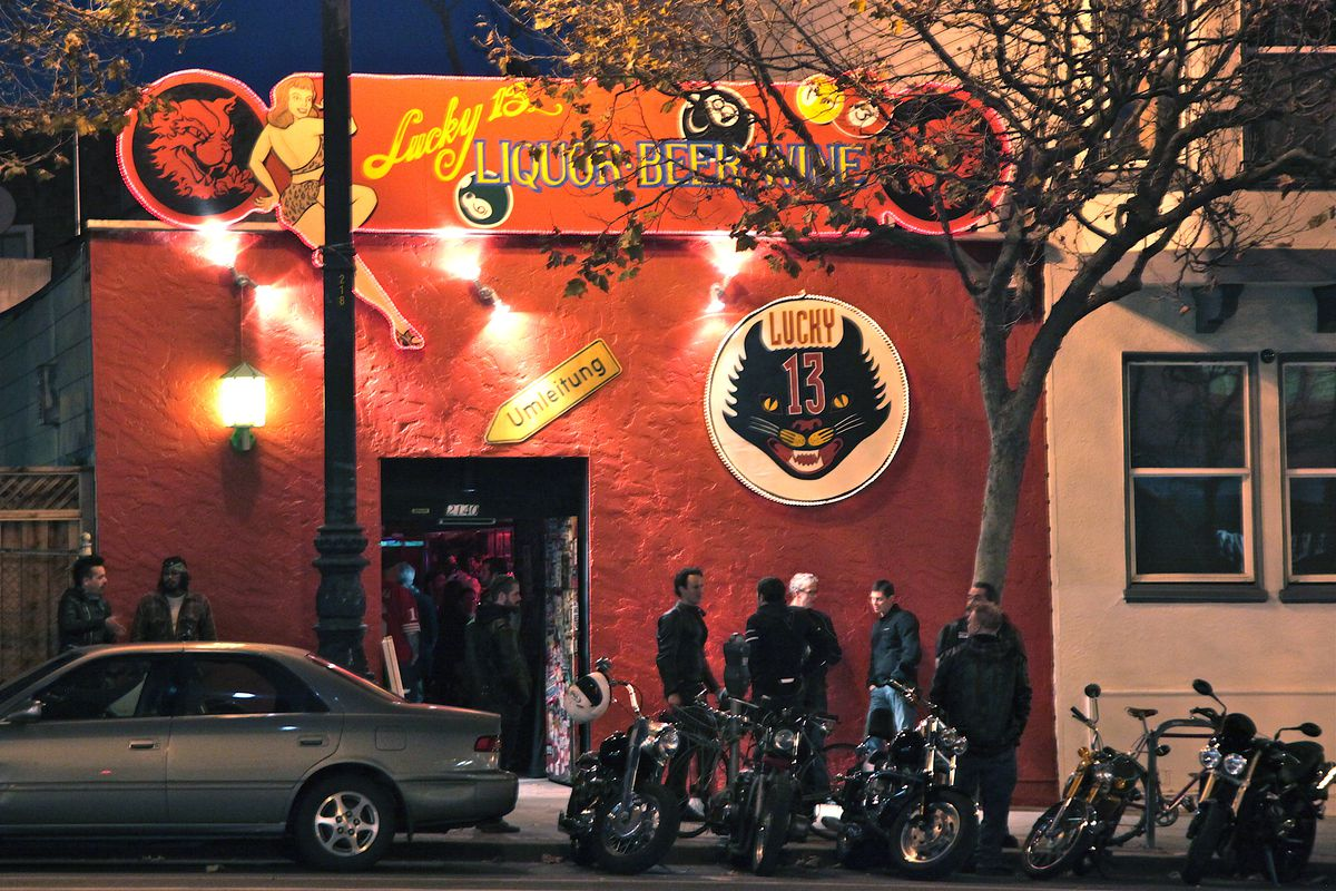 The Lucky 13 bar in San Francisco, painted red, with a snarling cat's head for a sign.