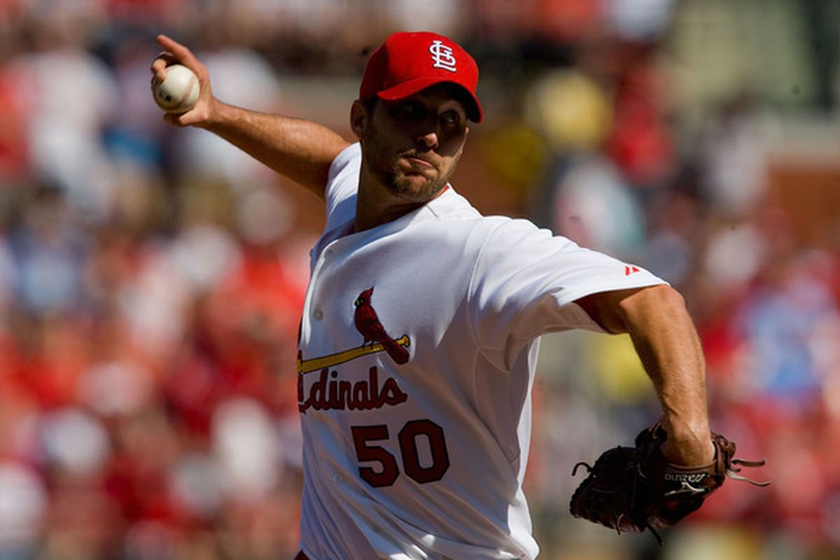 ST. LOUIS, MO - APRIL 12: Starting pitcher Adam Wainwright #50 of the St. Louis Cardinals throws against the Houston Astros in the home opener  at Busch Stadium on April 12, 2010 in St. Louis, Missouri.  (Photo by Dilip Vishwanat/Getty Images)