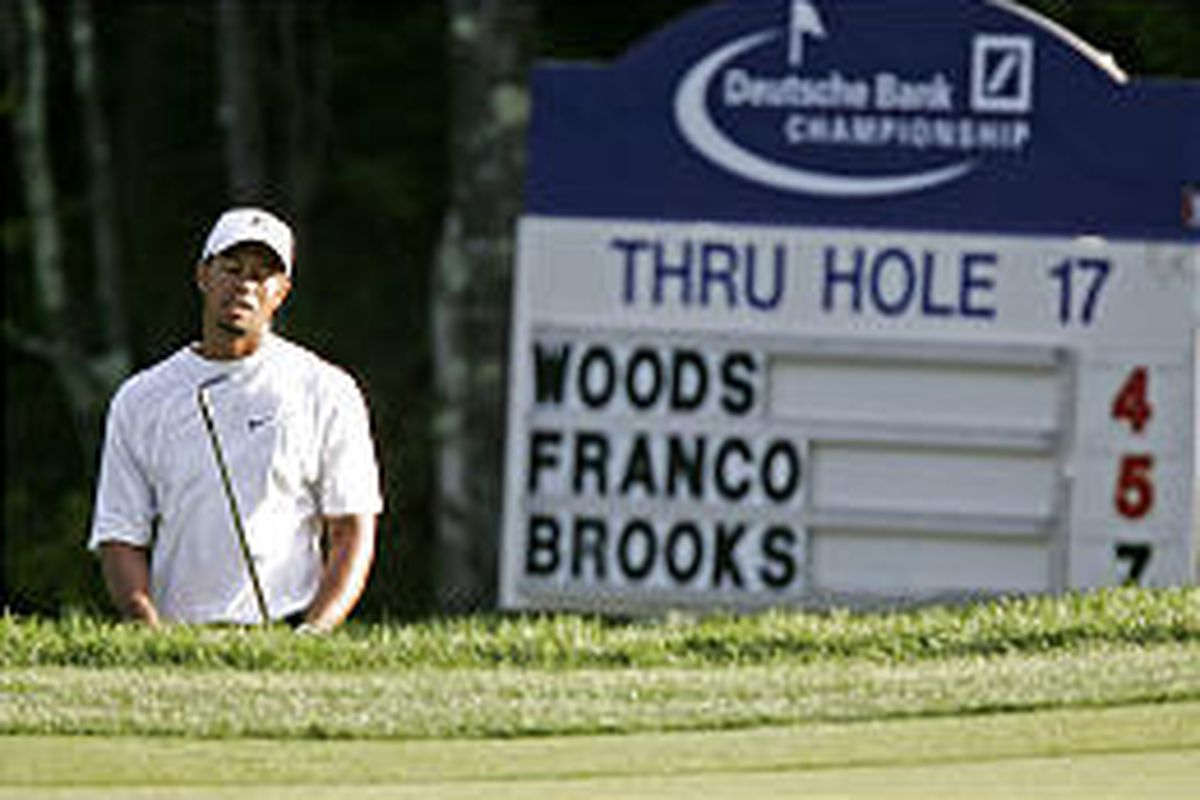 The face tells it all as Tiger Woods struggled through the second round of the Deutsche Bank Championship.