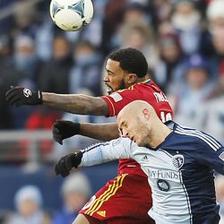Real's Robbie Findley and Kansas City's Aurelien Collin battle for the ball as Real Salt Lake and Sporting KC play Saturday, Dec. 7, 2013 in MLS Cup action.