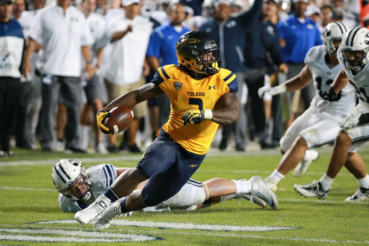 PROVO, UT - Toledo Rockets running back Kareem Hunt (3) weaves through the Brigham Young Cougars defensive secondary at Lavell Edwards Stadium.