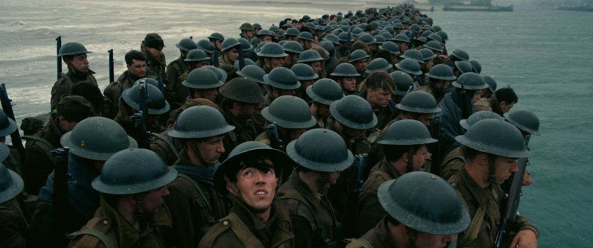 """Allied troops await their fate in this scene from Christopher Nolan's """"Dunkirk."""" 