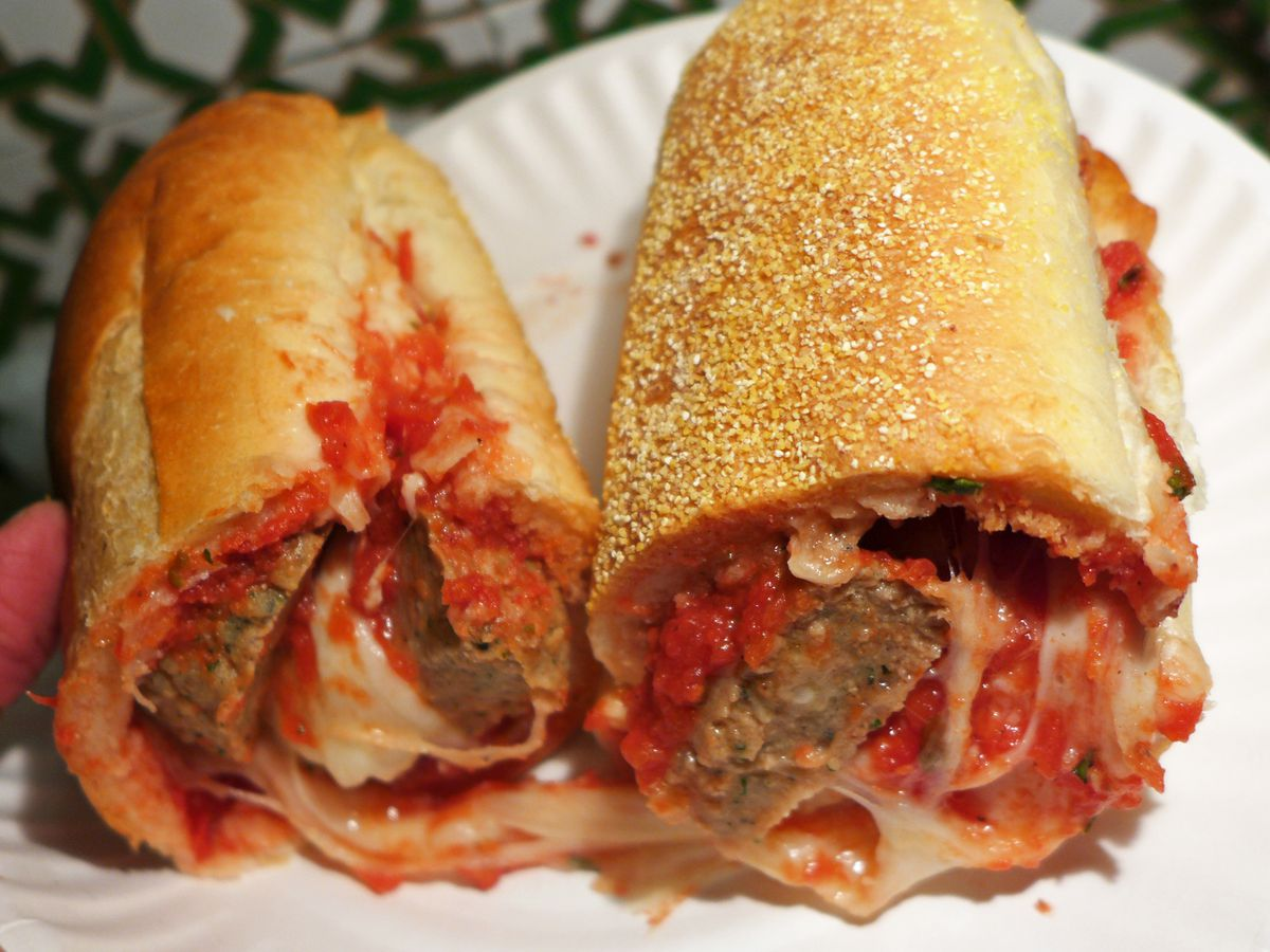 Meatball parm hero at Stella's, with giant meatballs and oozing cheese all around.