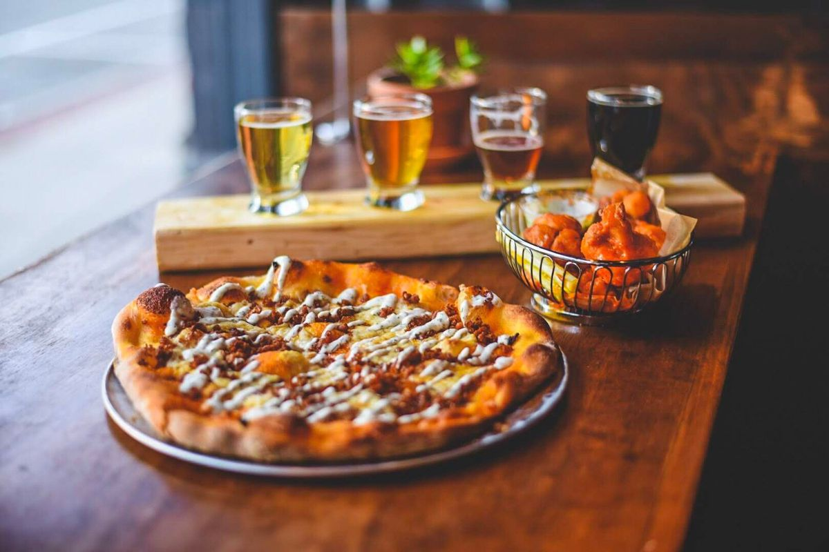 Pizza and beer from Rewild