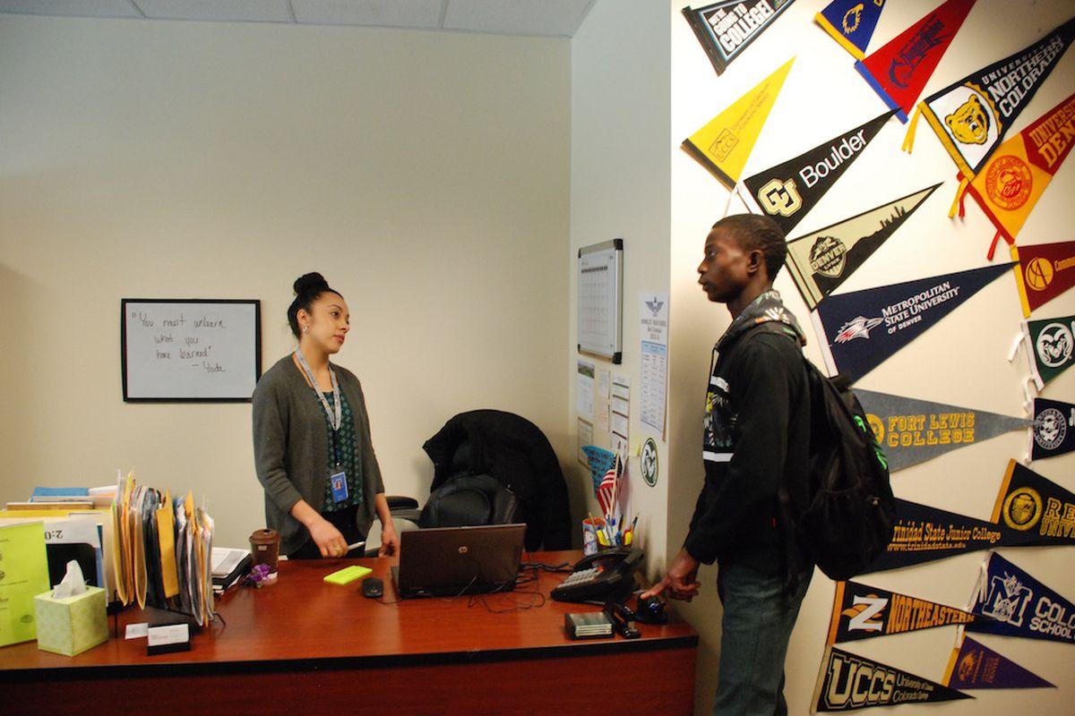 Hinkley College Center director Jazmin Lopez speaks with senior Moise Kombo in January.