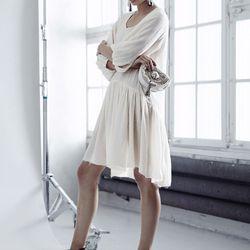 Bohemian off-white dress made of 100% organic silk, $199; embellished mules, $149