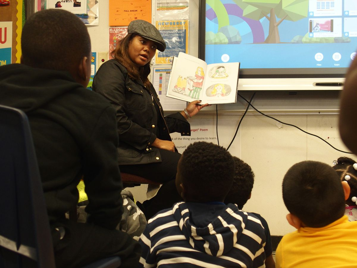 School board chairwoman Miska Clay Bibbs reads to students at Newberry Elementary where she also went to school.