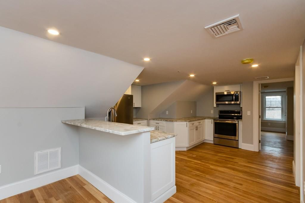 A sideview of that kitchen, from over a countertop.