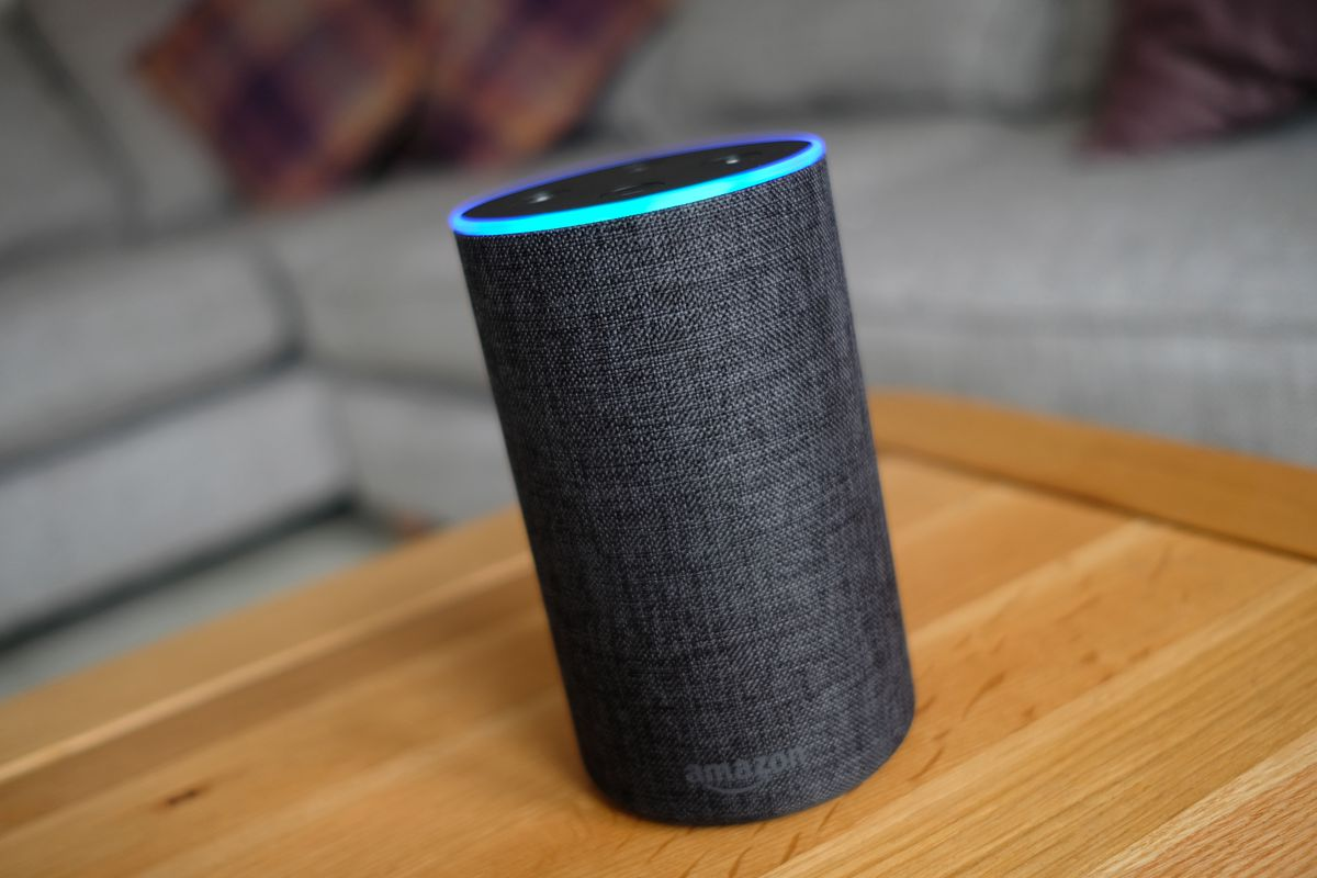 An Amazon Echo smart speaker on a table.