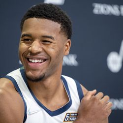 Utah Jazz guard Jared Butler (13) turns his head while laughing at an interview during the Utah Jazz media media day at Vivint Arena in Salt Lake City on Monday, Sept. 27, 2021.