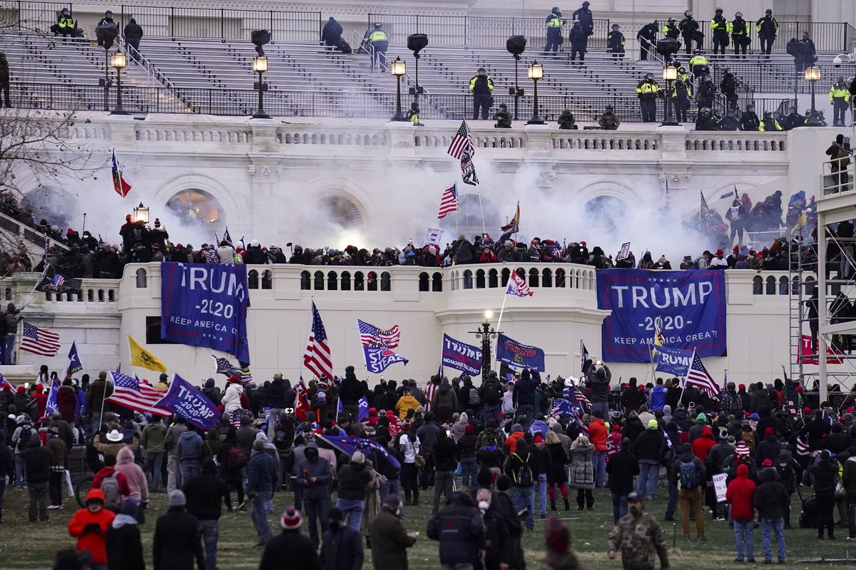 In this Jan. 6. 2021, file photo, people storm the Capitol in Washington.
