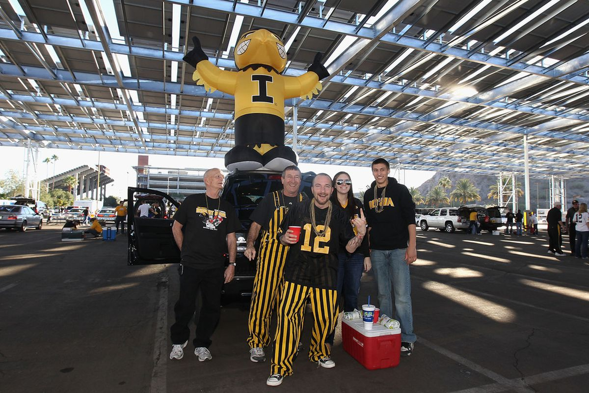 TEMPE, AZ - DECEMBER 30:  Fans of the Iowa Hawkeyes pose for a photo as they tailgate before the Insight Bowl against the Oklahoma Sooners at Sun Devil Stadium on December 30, 2011 in Tempe, Arizona.  (Photo by Christian Petersen/Getty Images)