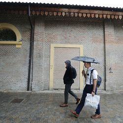 Elders Samuel Nagliati and Cole Draper, missionaries for The Church of Jesus Christ of Latter-day Saints, walk to the train station to pick up their new companions in Bologna, Italy, on Thursday, Sept. 16, 2021.