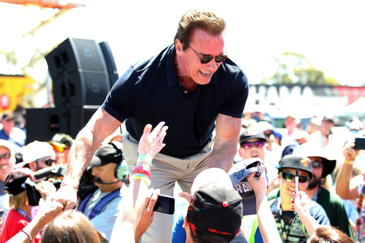 Actor and former governor of California Arnold Schwarzenegger greets fans at a NASCAR event on June 28, 2015, in Sonoma, California.