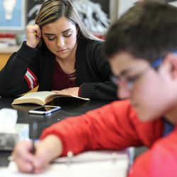 Chantelle Zamora, 18, and Asher Hardman, 13, hang out and study in the Our CASA space at West High School in Salt Lake City on Friday, Feb. 24, 2017. Our CASA spaces are part of an initiative to increase access to higher education for first-generation students and their families on Salt Lake City's west side. Asher is part of the Extended Learning Program that allows middle schoolers to take high school courses.