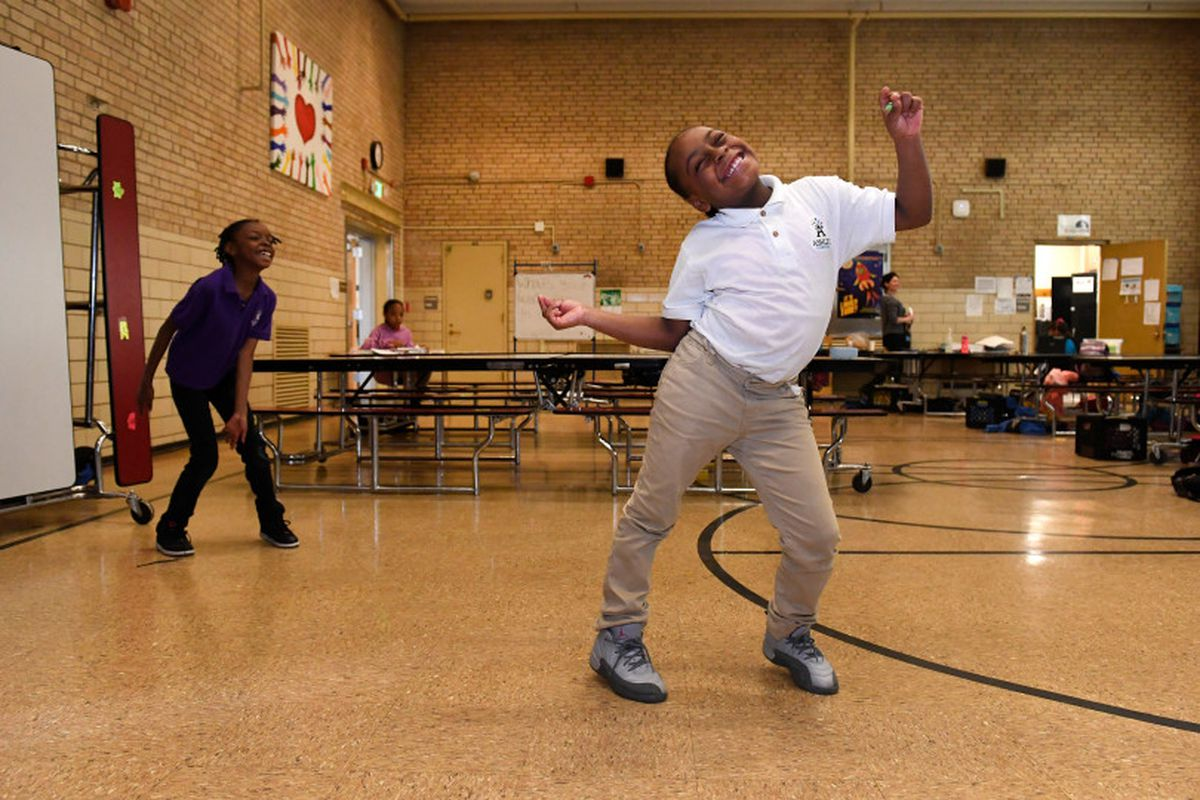 Hannah Moore, 8, shows off her moves during practice for an after school talent show that is part of the Scholars Unlimited After School program at Ashley Elementary school on March 10, 2017 in Denver, Colorado. Scholars Unlimited is an after school and summer program funded by the 21st Century Community Learning Center Grant, which is threatened to be cut entirely under the White House's budget cuts. The 21st Century Community Learning Center Grant served almost 20,000 students in Colorado betw