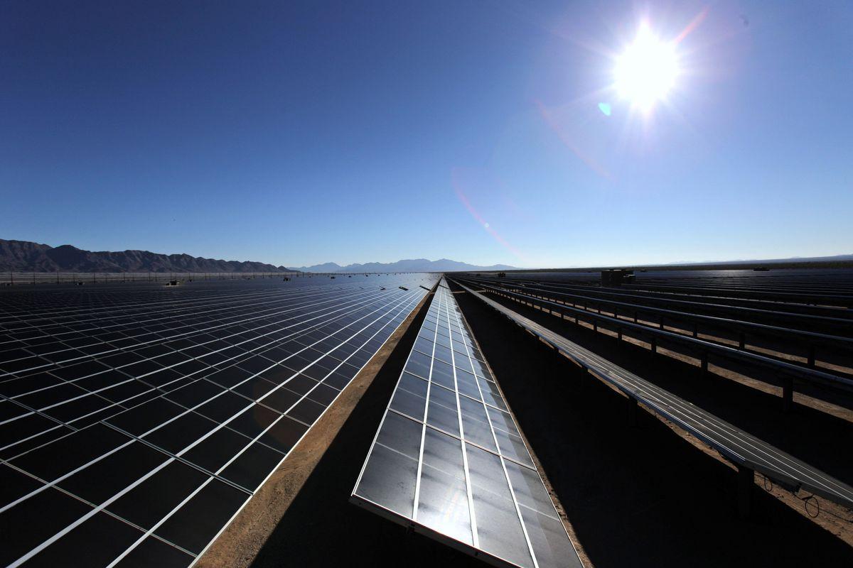 DESERT CENTER, CA - FEBRUARY 9: Photo-voltaic solar cells sit in the sun at the new 550-megawatt Desert Sunlight Solar Farm during a dedication ceremony for the facility on February 9, 2015 in Desert Center, California.