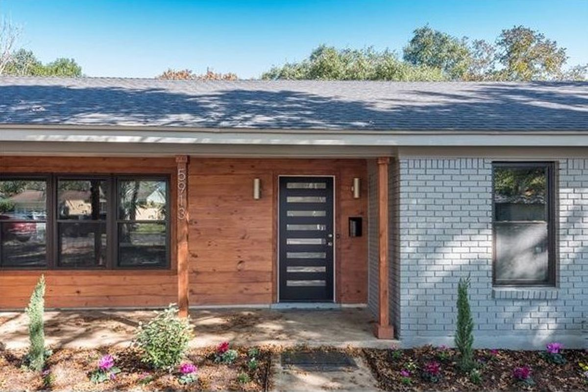 Midcentury ranch house remodeled with wooden siding, original white brick on right side, picture window and new door and drought-tolerant yard