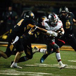 Mountain Ridge's Zander Hererra, right, intercepts through Wasatch's defense in a high school football game on Friday, Aug. 27, 2021, at Wasatch High School in Heber City. Mountain Ridge won 40-30.