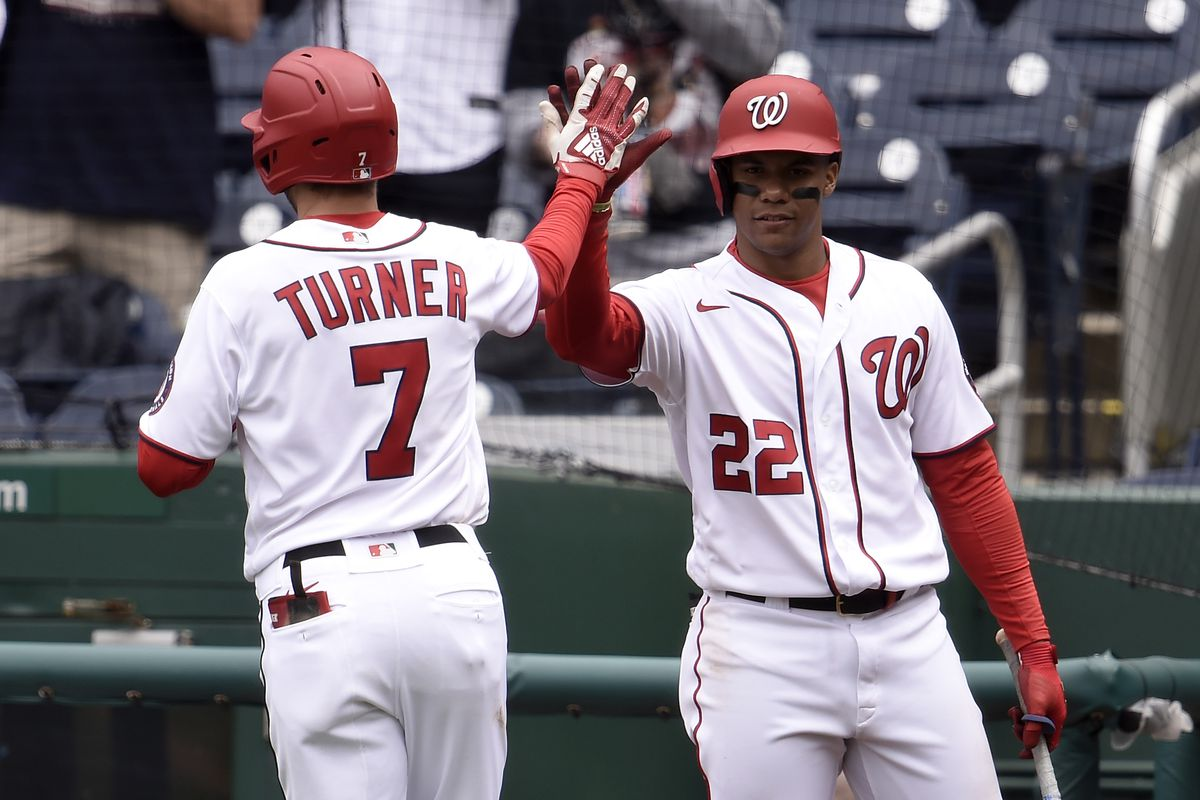 Trea Turner #7 of the Washington Nationals celebrates with Juan Soto #22 after hitting a home run in the eighth inning against the Arizona Diamondbacks at Nationals Park on April 18, 2021 in Washington, DC.