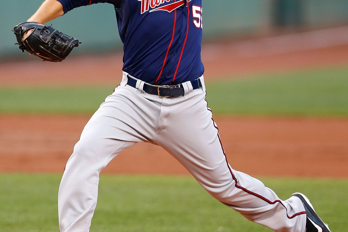 BOSTON, MA - AUGUST 03:  Brian Duensing #52 of the Minnesota Twins pitches against the Boston Red Sox during the game on August 3, 2012 at Fenway Park in Boston, Massachusetts.  (Photo by Jared Wickerham/Getty Images)