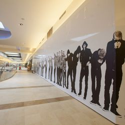"""Kenton Parker's inkjet print of himself lines a wall near Last Call by Neiman Marcus on the mall's second level. It's titled """"Out of Line."""""""