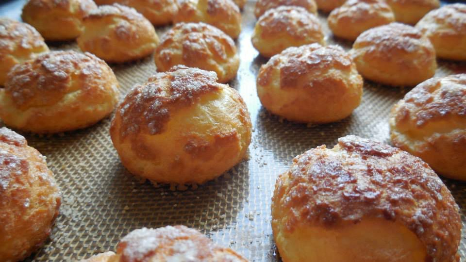 Pastries sit on a cooling rack