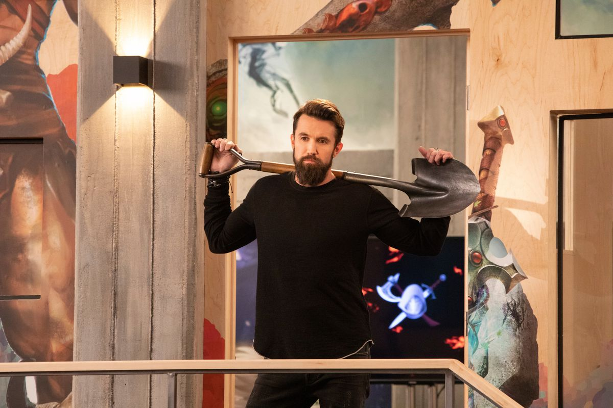 Rob McElhenney holds a shovel over his shoulders in a still from Mythic Quest: Raven's Banquet