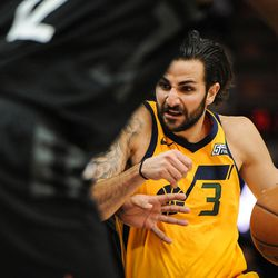 Utah Jazz guard Ricky Rubio (3) grimaces as he drives to the basket in the first half as the Utah Jazz host the Houston Rockets at Vivint Smart Home Arena Salt Lake on Thursday, Dec. 7, 2017.