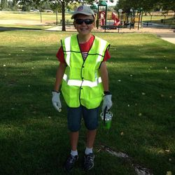 Matthew Mancil, 12, wears the gear a Union Pacific conductor gave him Thursday, July 17, 2014, in Clinton.
