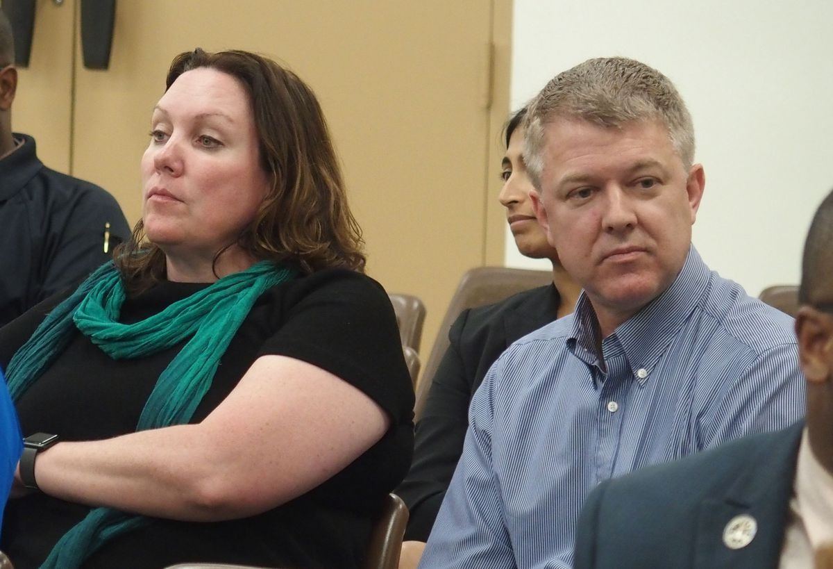 Megan Quaile, executive director of Green Dot Public Schools Tennessee, and national CEO Marco Petruzzi listen to school board members.