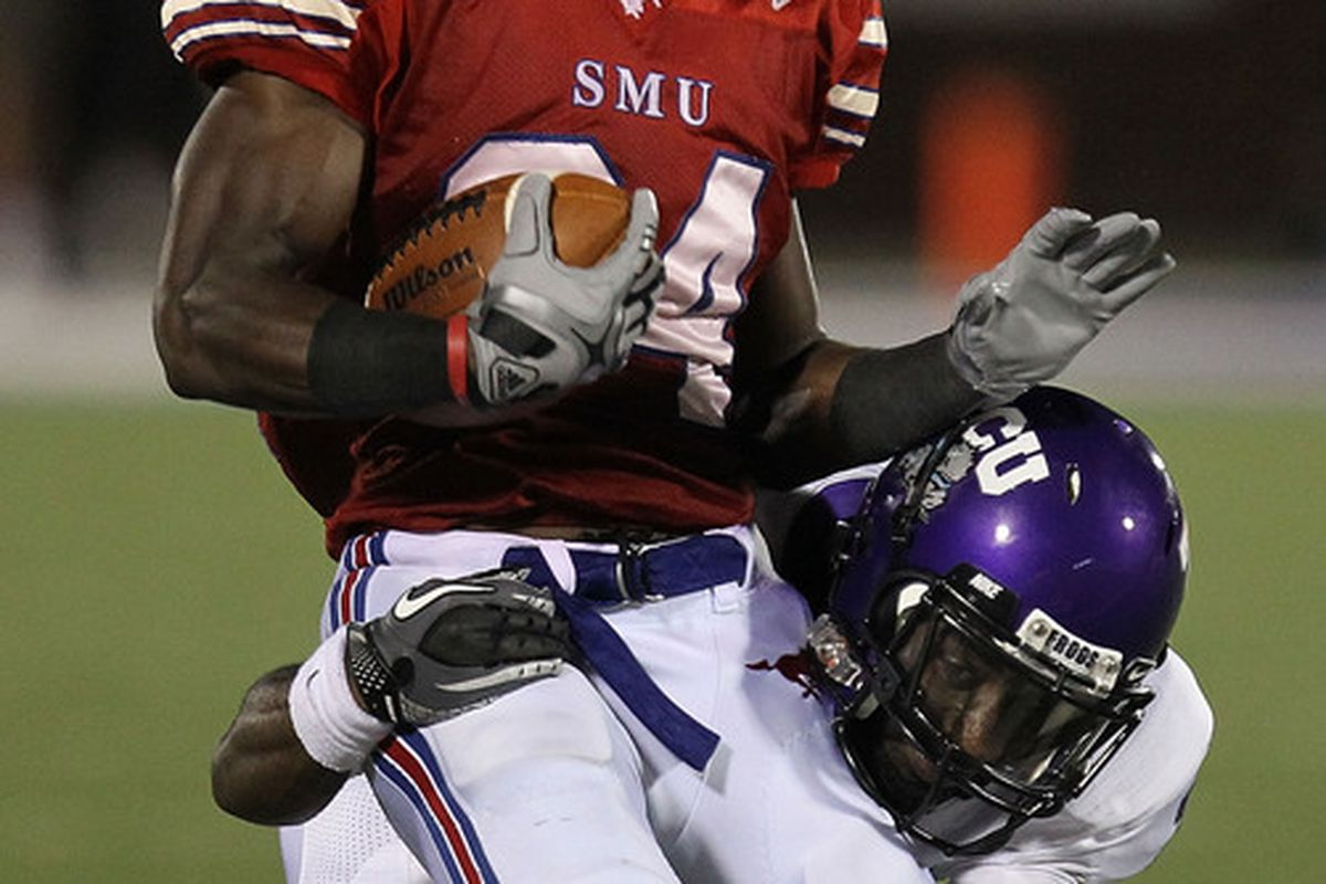 DALLAS - SEPTEMBER 24:   Wide receiver Aldrick Robinson #24 of the SMU Mustangs is tackled by Greg McCoy #7 of the TCU Horned Frogs at Gerald J. Ford Stadium on September 24 2010 in Dallas Texas.  (Photo by Ronald Martinez/Getty Images)