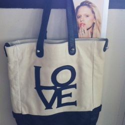 This adorable tote with leather trim is $140.