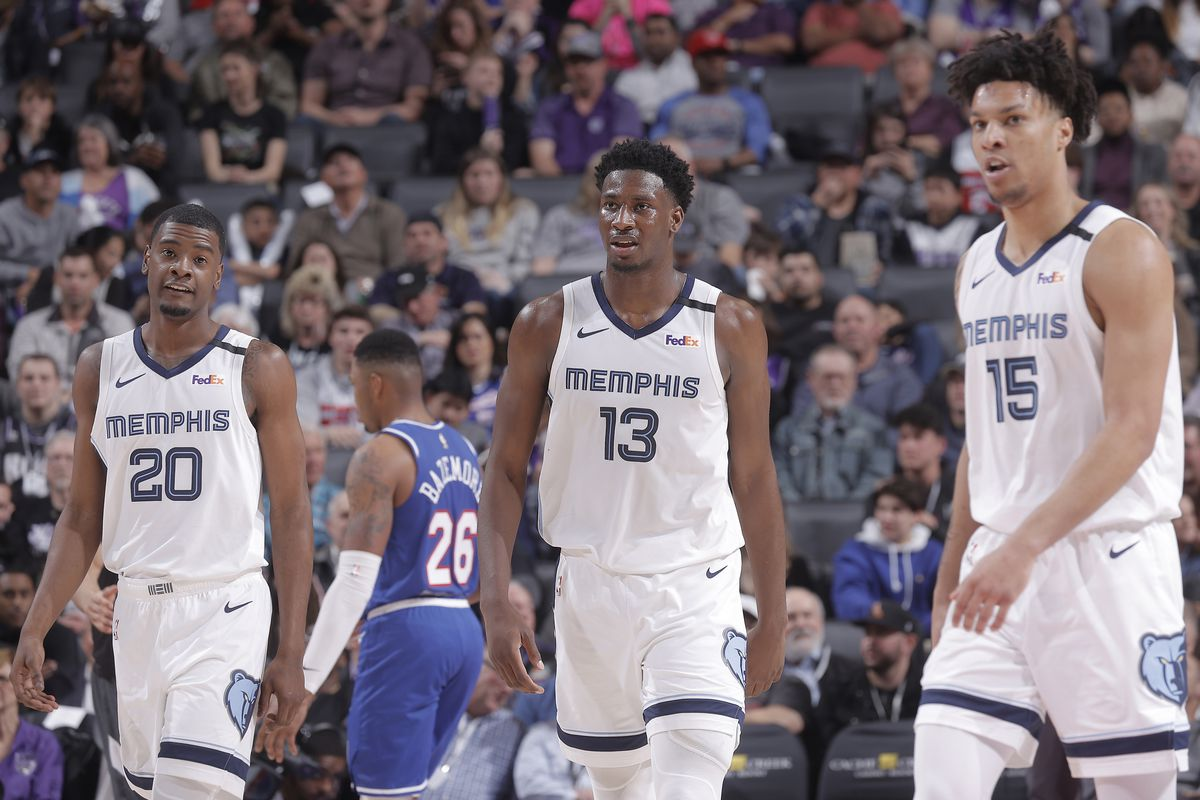 Josh Jackson , Jaren Jackson Jr. and Brandon Clarke of the Memphis Grizzlies look on during the game against the Sacramento Kings on February 20, 2020 at Golden 1 Center in Sacramento, California.