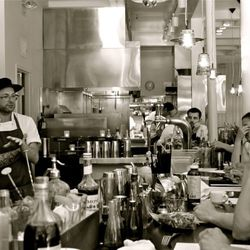 Chef Anthony Strong goes over dishes during lineup