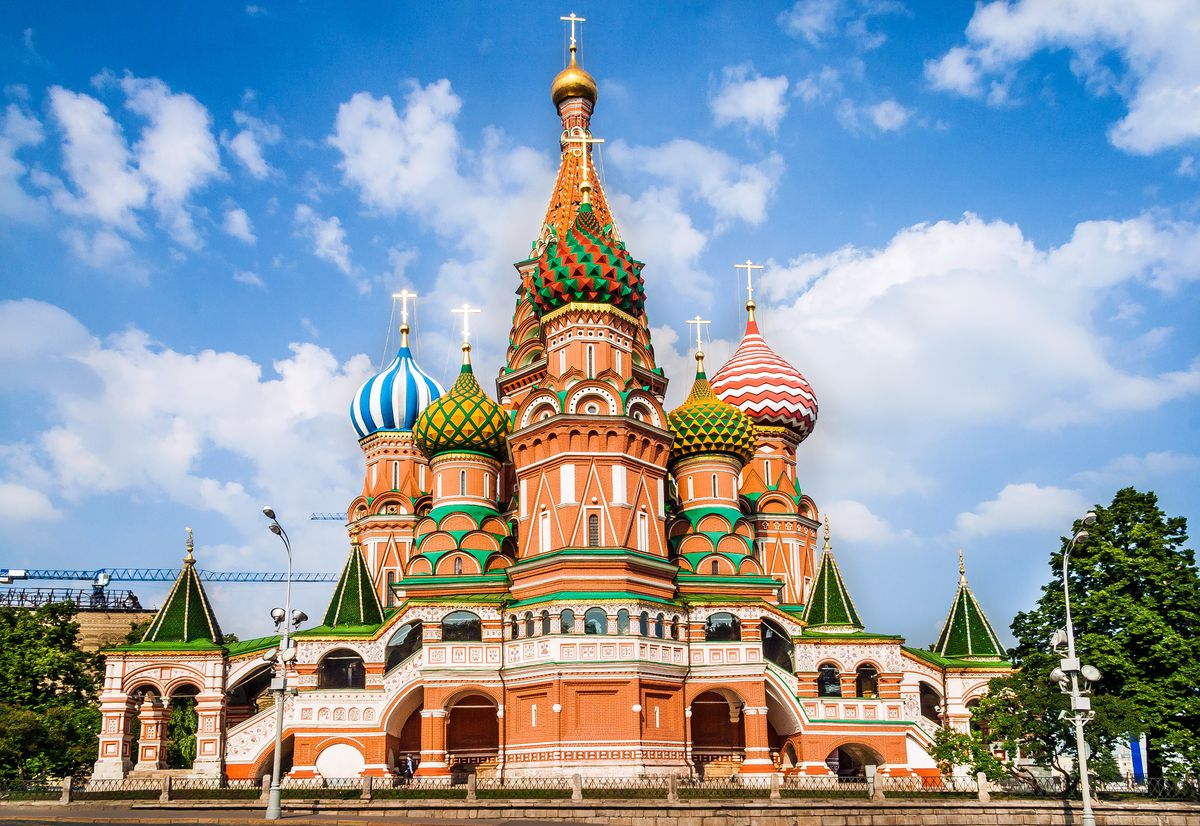 The exterior of St. Basil's Cathedral in Russia. The facade is colorful with multiple spires.