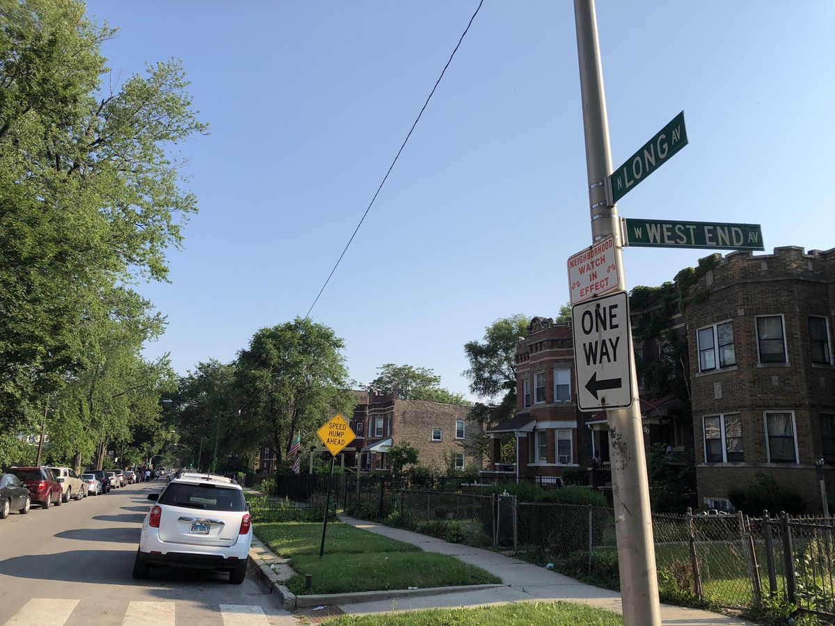 A street sign marks the 100 block of North Long Avenue, where police Cmdr. Patrina Wines and another officer were shot after police dispersed a crowd gathered for a Fourth of July block party. Wines was struck in the foot as she talked with neighborhood residents.