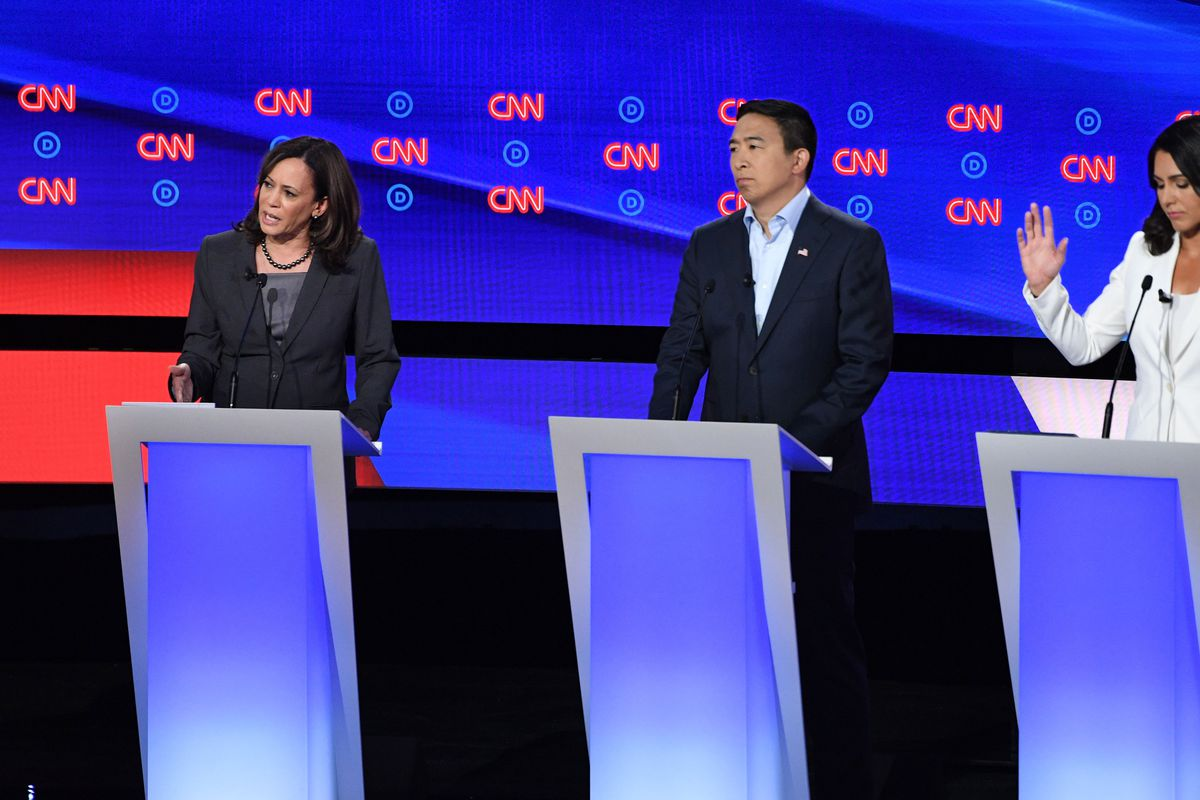 Kamala Harris, Andrew Yang, and Tulsi Gabbard on stage during the second round of Democratic presidential debates.