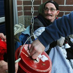 Doug Holladay, a former Salvation Army worker who is fighting terminal lung cancer, rings a bell for donations a final time in Riverdale, Thursday, Dec. 5, 2013.