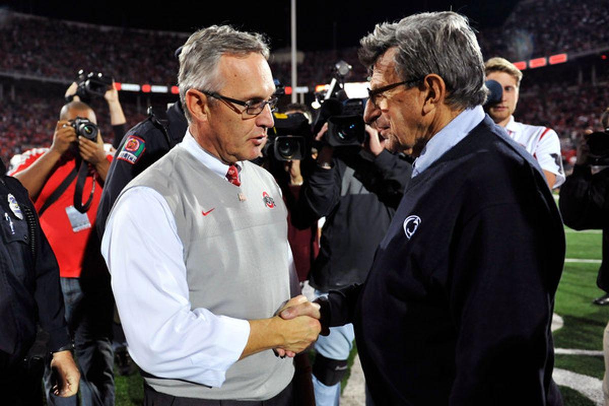 2 Sweatervests, 1 Handshake.(Photo by Jamie Sabau/Getty Images)