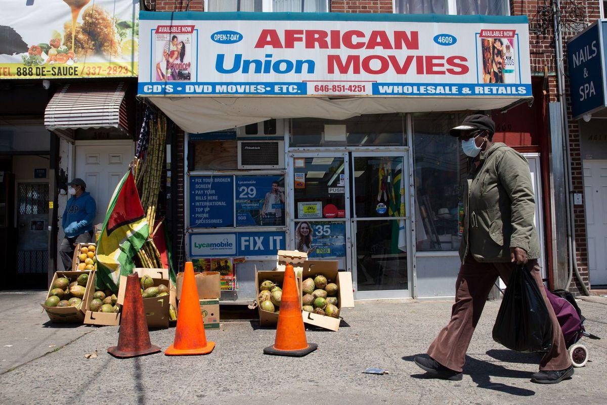 A vendor sells fresh produce on Church Avenue in East Flatbush, Brooklyn during the coronavirus epidemic, May 13, 2020.